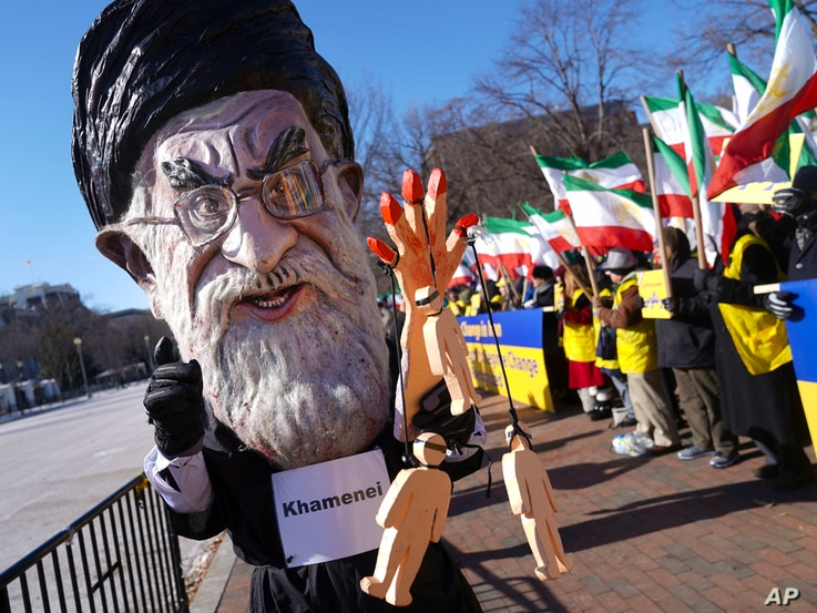 A demonstrator dressed as the Iranian Supreme Leader Ayatollah Ali Khamenei participates in a rally across from the White House in Washington, Jan. 6, 2018, in solidarity with anti-government demonstrators in Iran. Iran has seen its largest anti-gove...