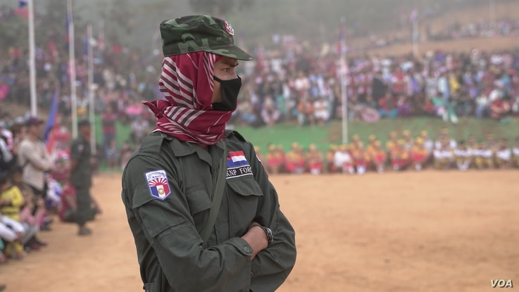 A Karen National Police Force officer watches the Karen Revolution day ceremonies Jan. 31, 2019, in Karen state, Myanmar, near the Thai-Myanmar border.