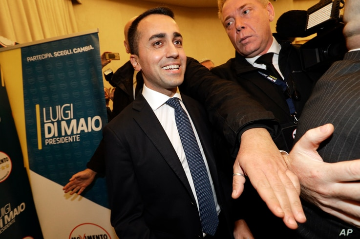 5-Stars Movement's leader Luigi Di Maio smiles as he arrives for a press conference on the preliminary election results, in Rome, March 5, 2018.