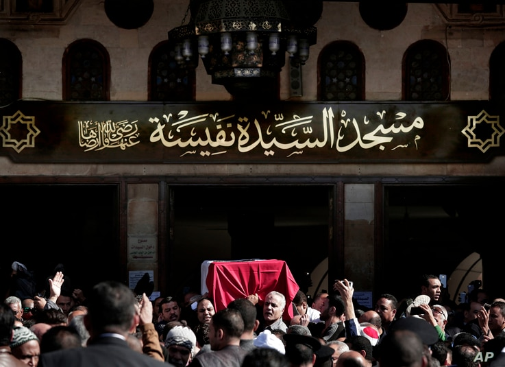 People carry the coffin of Egyptian singer and actress Shadia, during her funeral procession, at the Sayeda Nafisa Mosque in Cairo, Egypt, Wednesday, Nov. 29, 2017.