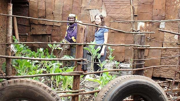 Kibera's food producers grow their crops directly alongside densely-packed shacks. Nierenberg, pictured here with one of the farmers, says they are an example to the world