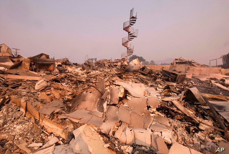 The charred remains of the burned out home are seen in Malibu, Calif., Nov. 10, 2018.