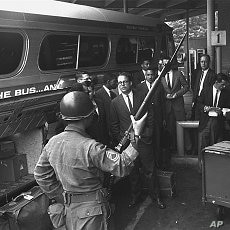 "A new busload of ""Freedom Riders,"" including four white college professors and three Negro students, arrives in Montgomery, Alabama, under the protection of police and National Guard in this May 24, 1961, file photo"