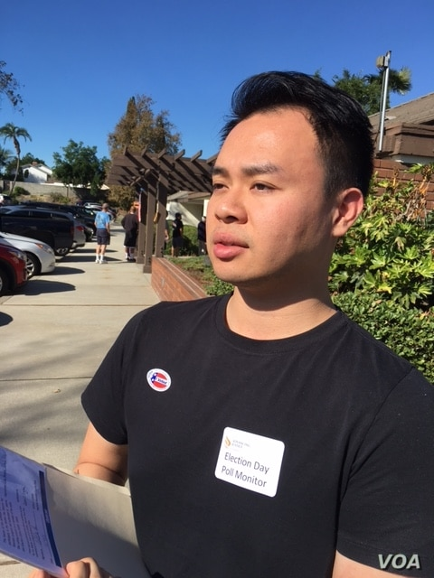 Poll watcher Eddie Hu of the citizen group Asian Americans Advancing Justice — Los Angeles says the election is going smoothly at the polling station in the San Gabriel Valley, an area near Los Angeles with a large Asian American population. (M. O'...
