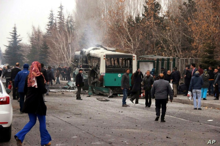 A destroyed public bus at the scene of a car bomb attack in central Anatolian city of Kayseri, Turkey, Saturday, Dec. 17, 2016.
