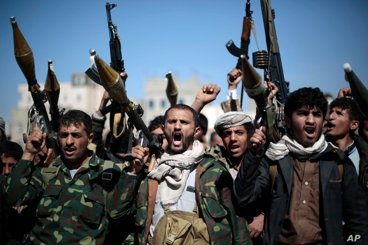 FILE - Tribesmen loyal to Houthi rebels hold their weapons as they chant slogans during a gathering to mobilize more fighters into battlefronts in several Yemeni cities, in Sana'a, Yemen, Nov. 24, 2016.