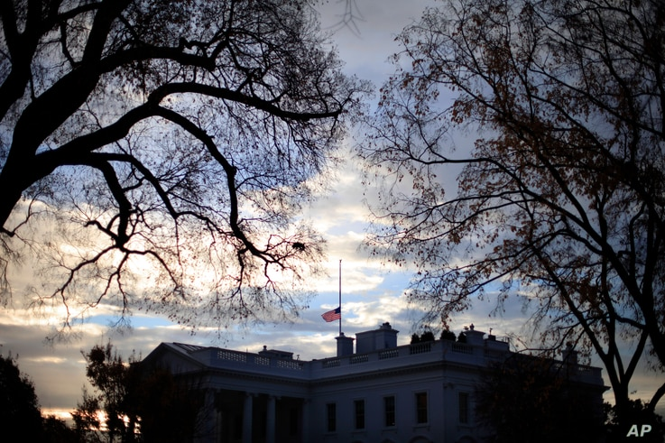 A flag flies at half-staff above the White House in Washington, early Friday morning, Nov. 22, 2013. President Barack Obama ordered that flags be lowered at government buildings to mark the 50th anniversary of President John F. Kennedy's assassinatio...