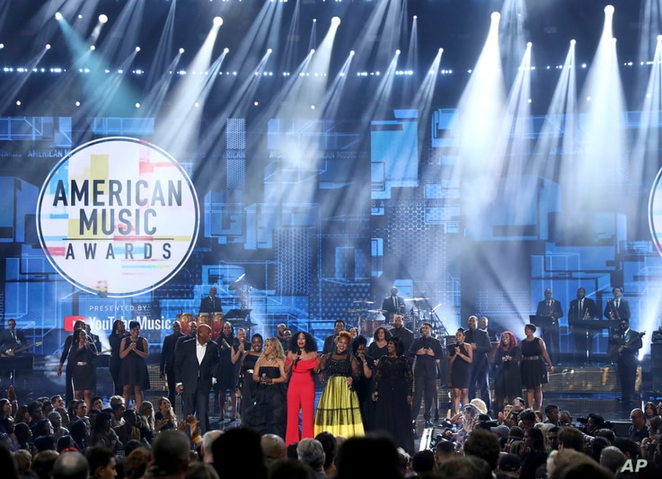 Tracee Ellis Ross, center, speaks at the conclusion of the American Music Awards following a tribute to the late singer Aretha Franklin on Tuesday, Oct. 9, 2018, at the Microsoft Theater in Los Angeles.