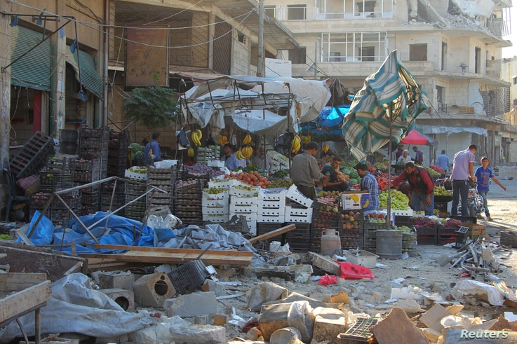 Damage is seen near produce stands after airstrikes on a market in the rebel-controlled city of Idlib, Syria, Sept. 10, 2016.