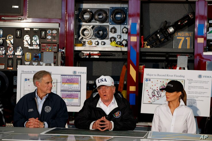 President Donald Trump, flanked by Texas Gov. Greg Abbott and first lady Melania Trump, speaks during a briefing on Harvey relief efforts, Aug. 29, 2017, in Corpus Christi, Texas.