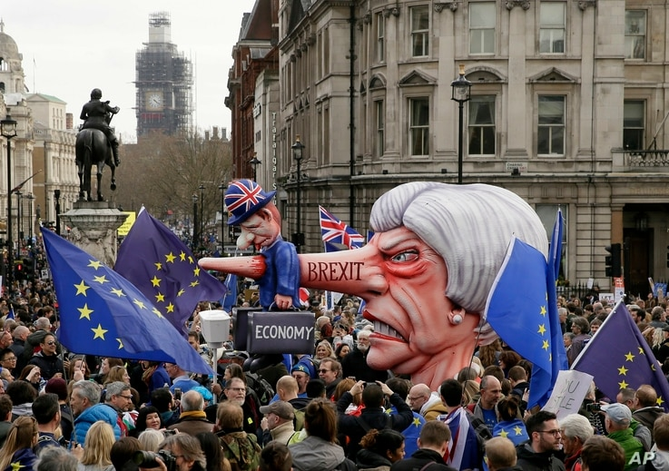 An effigy of British Prime Minister Theresa May is wheeled through Trafalgar Square during a Peoples Vote anti-Brexit march in London, March 23, 2019. The march, organized by the People's Vote campaign is calling for a final vote on any proposed Brex...