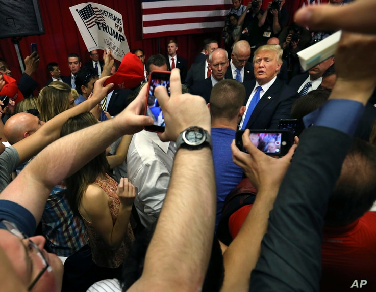 Republican presidential candidate Donald Trump, center right, greets supporters after speaking at a campaign event, May 19, 2016 in Lawrenceville, N.J.
