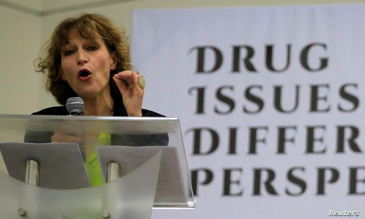 """FILE - Agnes Callamard, a United Nations Special Rapporteur on extrajudicial, summary or arbitrary executions, gestures while delivering a statement during a """"Drug issues, Different Perspectives"""" forum at a compound of University of the Philippines i..."""