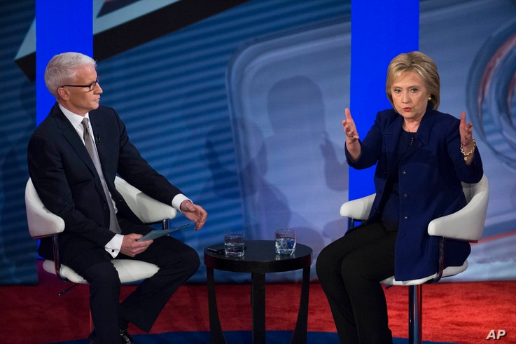 Democratic presidential candidate Hillary Clinton, right, speaks alongside host Anderson Cooper during A Democratic primary town hall sponsored by CNN, in Derry, N.H., Feb. 3, 2016.
