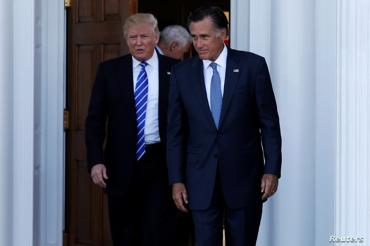 U.S. President-elect Donald Trump (L) and former Massachusetts Governor Mitt Romney emerge after their meeting at the main clubhouse at Trump National Golf Club in Bedminster, New Jersey, U.S., November 19, 2016.