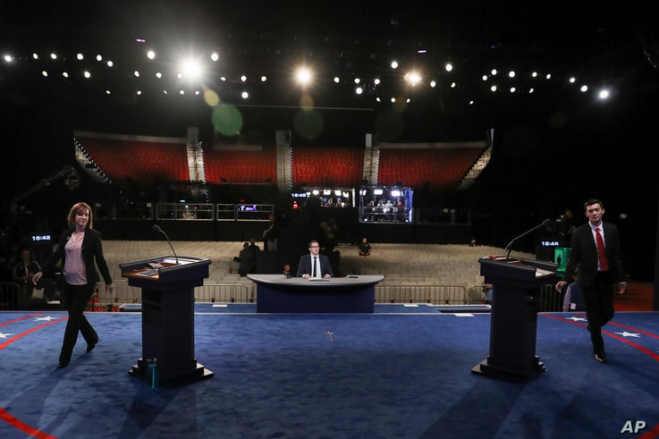 Students take positions behind the podium for a dress rehearsal Oct. 18, 2016, before the third presidential debate between Republican presidential nominee Donald Trump and Democratic presidential nominee Hillary Clinton at UNLV in Las Vegas.