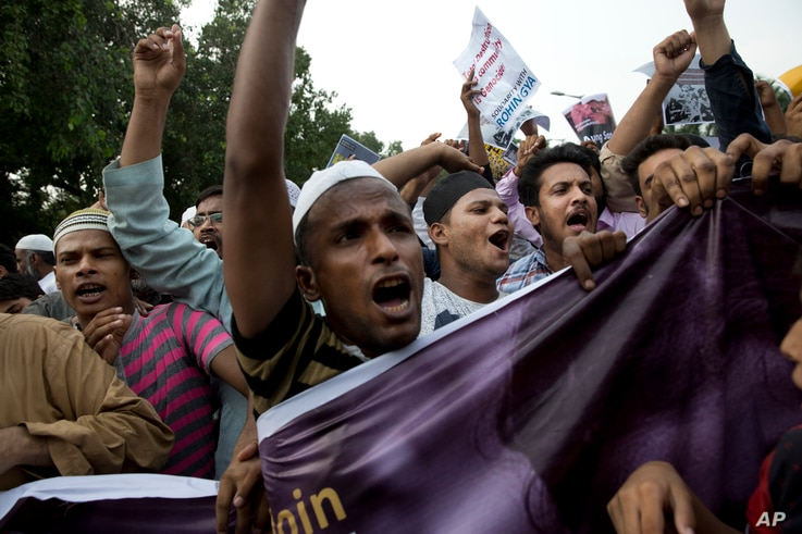 Indian Muslims shout slogans during a protest against the persecution of Rohingya Muslims in Myanmar, in New Delhi, India, Sept. 13, 2017. The protesters criticized Myanmar leader Aung San Suu Kyi, asking whether she was given a Nobel Peace Prize for...