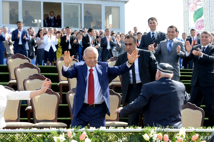 FILE - Uzbekistan's President Islam Karimov, center, dances during a state celebration of the Nowruz holiday marking the beginning of spring in Tashkent, March 21, 2015. Karimov died on Friday and his funeral is planned for Saturday.
