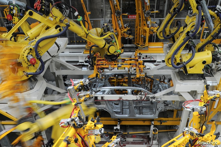 FILE - A view inside the Dongfeng Peugeot Citroen factory before it starts up production in Chengdu, Sichuan province, China, Sept. 6, 2016.