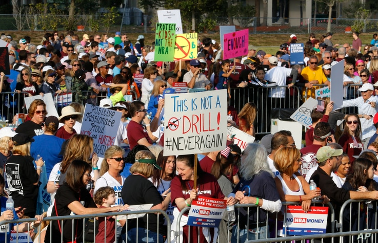 Participants gather during the March For Our Lives-Parkland event, March 24, 2018, in Parkland, Fla.