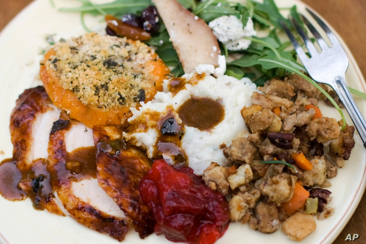 FILE — A traditional Thanksgiving dinner often includes turkey, gravy, cranberry sauce, mashed potatoes, stuffing and sweet potatoes.