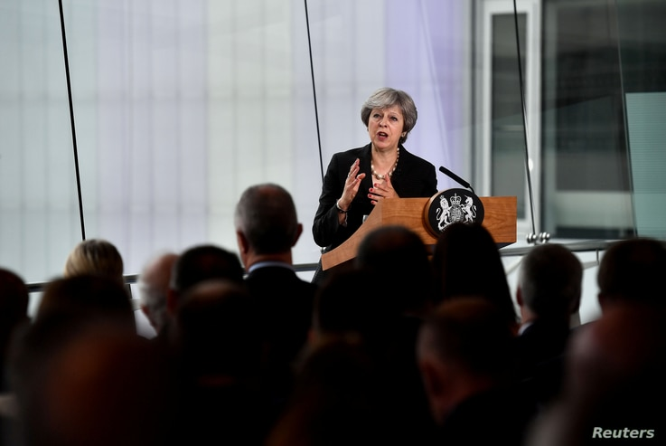 Britain's Prime Minister Theresa May delivers a speech at the Waterfront Hall in Belfast, Northern Ireland, July 20, 2018.