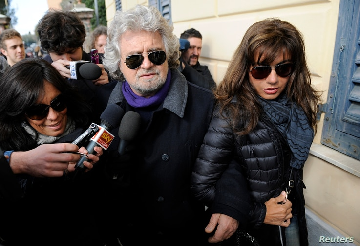 Five Star Movement leader and comedian Beppe Grillo and his wife Parvin Tadjik arrive to cast their votes in Genoa, Italy, Feb. 25, 2013.