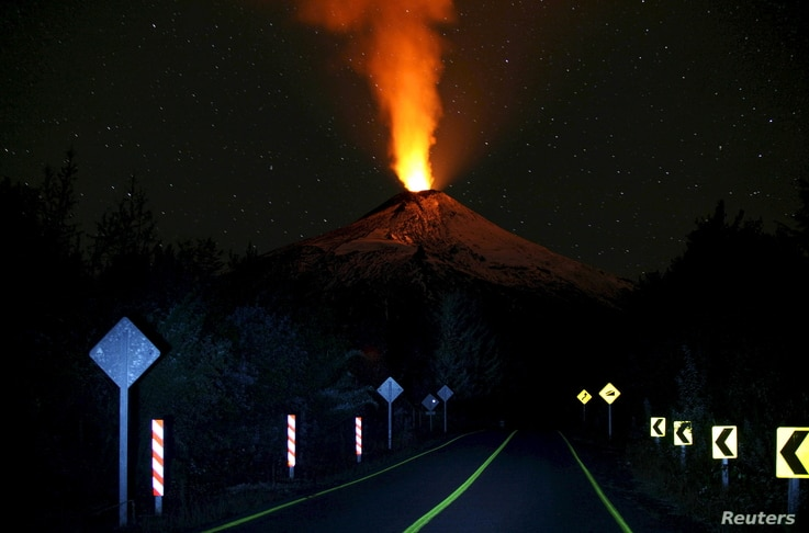 Smoke and lava spew from the Villarrica volcano, as seen from Pucon town, in the south of Santiago, Chile, April 22, 2015.