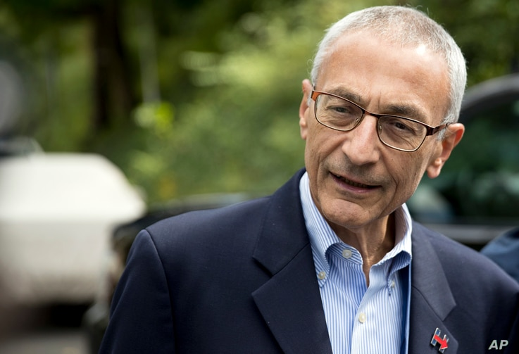 Hillary Clinton campaign chairman John Podesta speaks to members of the media outside Clinton's home in Washington, Oct. 5, 2016.