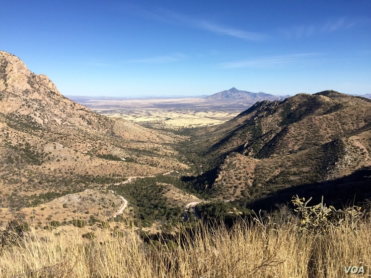 The U.S.-Mexico barrier can be seen in the distance from Montezuma Pass at Arizona's Coronado National Memorial, elevation 2,004 meters.  (R. Taylor/VOA)