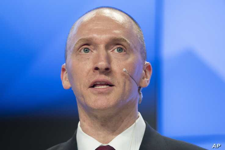 FILE - Carter Page, a former foreign policy adviser of U.S. President-elect Donald Trump, speaks at a news conference at RIA Novosti news agency in Moscow, Russia, Dec. 12, 2016.