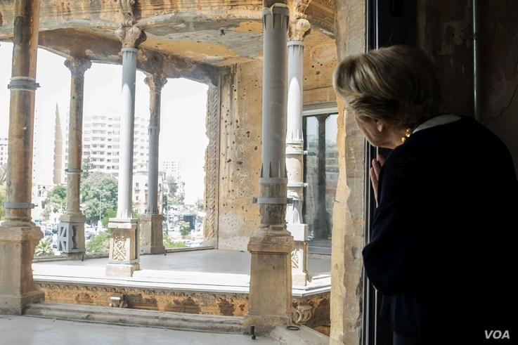 Evelyne Kozah looks out from the building. She is wife of the late Fouad Kozah, who extended the building in 1932.