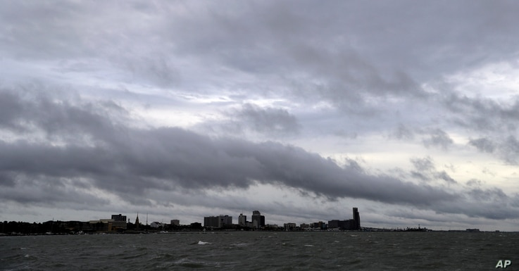 Clouds and rain form over downtown Corpus Christi, Texas, as the outer bands of Hurricane Harvey move closer to shore, Aug. 25, 2017.