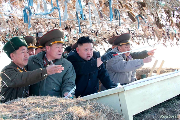 North Korean leader Kim Jong-Un visits the Wolnae Islet Defence Detachment in the western sector of the front line, which is near Baengnyeong Island of South Korea, March 11, 2013. (KCNA)