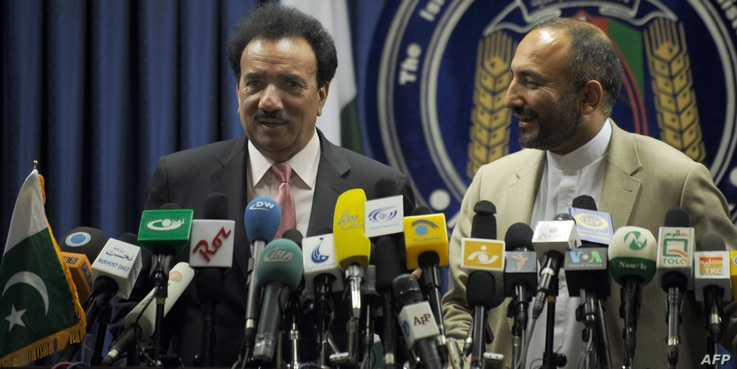 Afghanistan's national security adviser Haneef Atmar, at the time the country's interior minister (R) listens while Pakistani Federal Minister for Interior A. Rehman Malik (L) talks during a press conference at the Interior Ministry in Kabul on July ...
