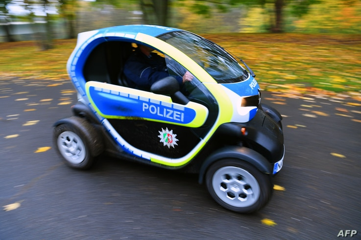 """A police car run on electric energy drives along a street at the """"Bonn Zone"""" on Nov. 8, 2017, during the COP23 U.N. Climate Change Conference in Bonn, Germany."""