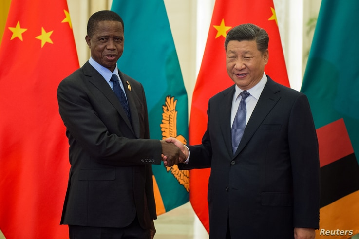 FILE - Zambia's President Edgar Lungu shakes hands with China's President Xi Jinping before their bilateral meeting at the Great Hall of the People in Beijing, China, Sept. 1, 2018.