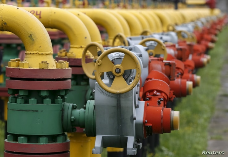 FILE - Pipes and valves are seen at an underground gas storage facility near Striy, Ukraine. Ukraine this week dismissed as unacceptable a natural gas transit proposal by Russian energy giant Gazprom, saying planned reductions in volume would yield a...