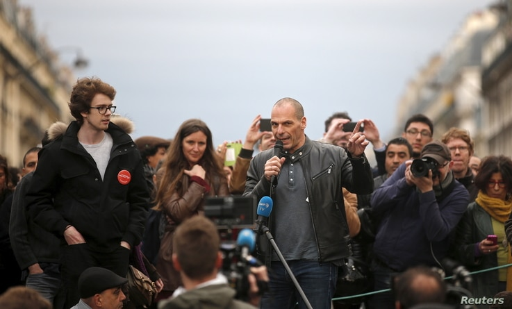 """Former Greek Finance Minister Yanis Varoufakis speaks in front of supporters of social media-driven movement """"Nuit Debout"""" (Up All Night), during their daily gathering on the Place de la Republique in Paris, France, against a French labour law propos..."""