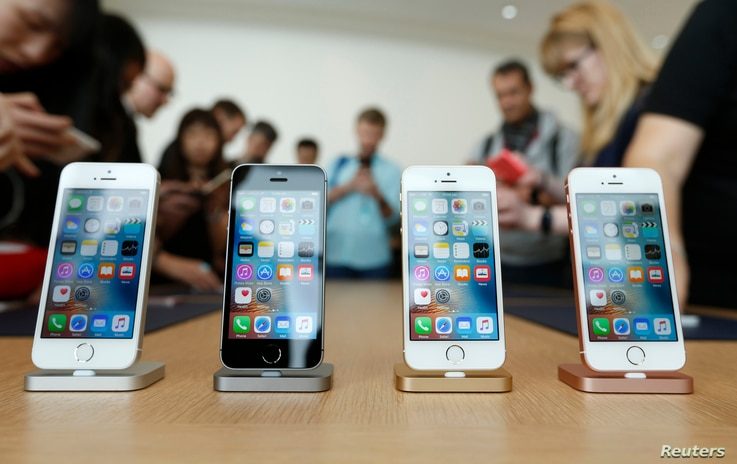 The new iPhone SE is seen on display during an event at the Apple headquarters in Cupertino, California, March 21, 2016.