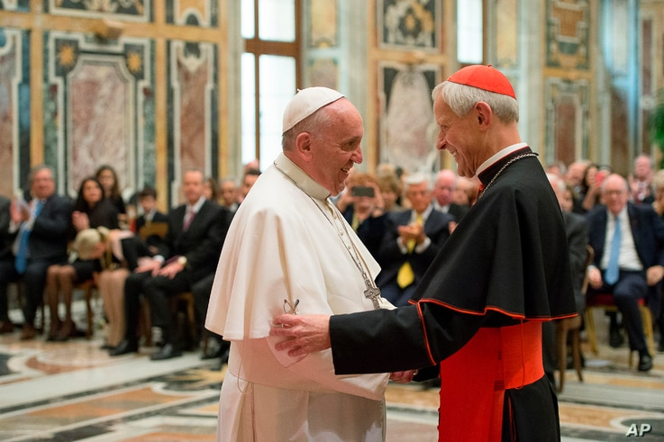 FILE -Pope Francis (L) talks with Papal Foundation Chairman Cardinal Donald Wuerl, Archbishop of Washington, D.C., during a meeting with members of the Papal Foundation at the Vatican, April 17, 2015.