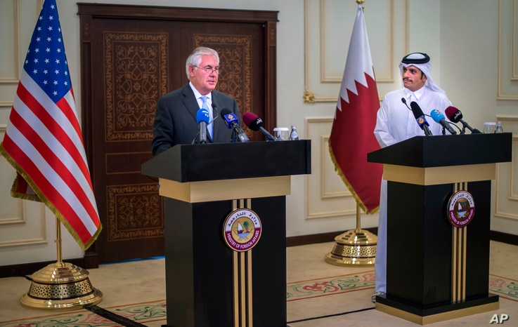 U.S. Secretary of State Rex Tillerson, left, and the Qatari Minister of Foreign Affairs Sheikh Mohammed bin Abdulrahman Al Thani take part in a press conference in Doha, Qatar, July 11, 2017.