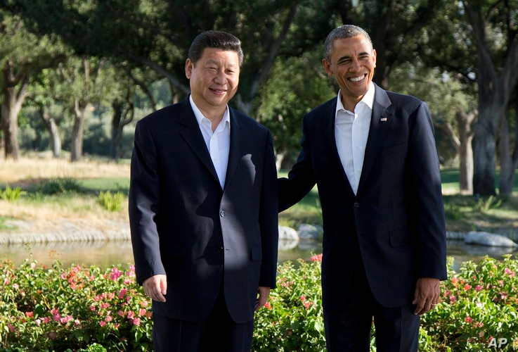 President Barack Obama stands with Chinese President Xi Jinping at the Annenberg Retreat at Sunnylands as they meet for talks in Rancho Mirage, California, June 7, 2013.