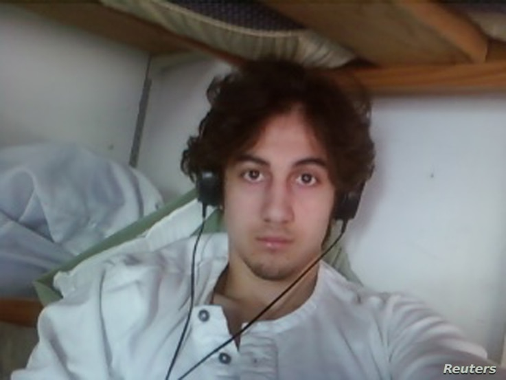 Dzhokhar Tsarnaev is pictured in this handout photo presented as evidence by the U.S. Attorney's Office in Boston, Massachusetts on March 23, 2015. Tsarnaev was heavily influenced by al Qaeda literature and lectures, some of which was found on his la