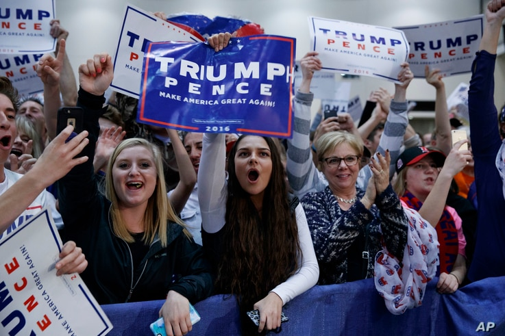 Supporters of Republican presidential candidate Donald Trump cheer during a campaign rally, Nov. 8, 2016, in Grand Rapids, Mich.