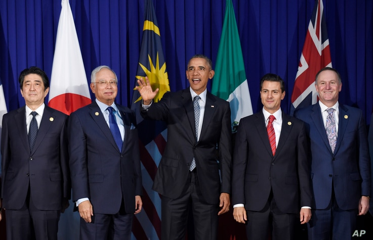 President Barack Obama, center, and other leaders of the Trans-Pacific Partnership countries pose for a photo in Manila, Philippines, Nov. 18, 2015.