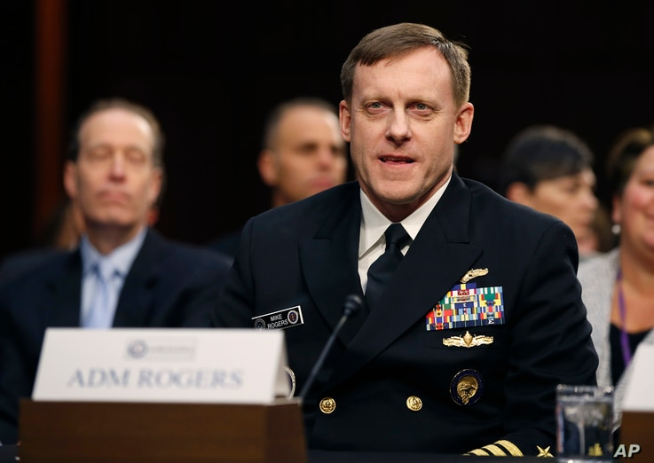 U.S. Cyber Commander Commander, National Security Agency Director Adm. Michael Rogers testifies on Capitol Hill in Washington, Feb. 9, 2015.