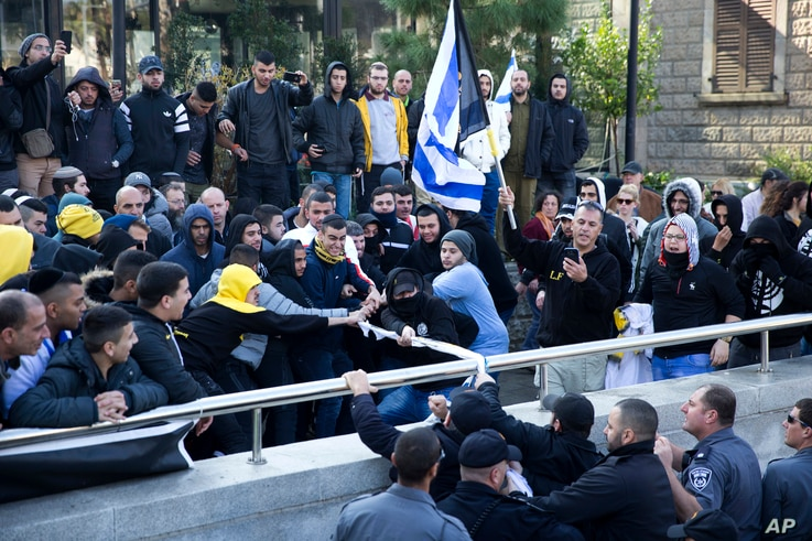 Right wing supporters of Israeli solider, Sgt. Elor Azaria, scuffle outside a Israeli military court in Tel Aviv, Israel, Jan. 4, 2017. Scuffles erupted outside the court during the proceedings.