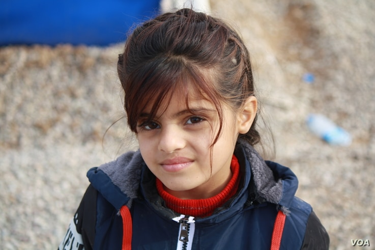 Displaced families from some areas say girls as young as 10-years-old are required to wear veils under Islamic State rule, while in other areas militants are more lenient, imposing dress codes on teenagers and adults. Dec. 8, 2016 in Hassan Sham, Kur...