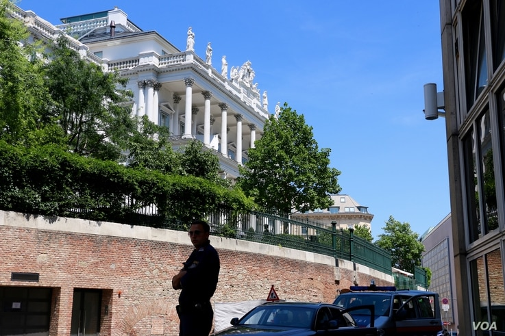 A police officer outside the Palais Coburg where closed-door nuclear talks with Iran take place in Vienna, Austria, July 4, 2015.